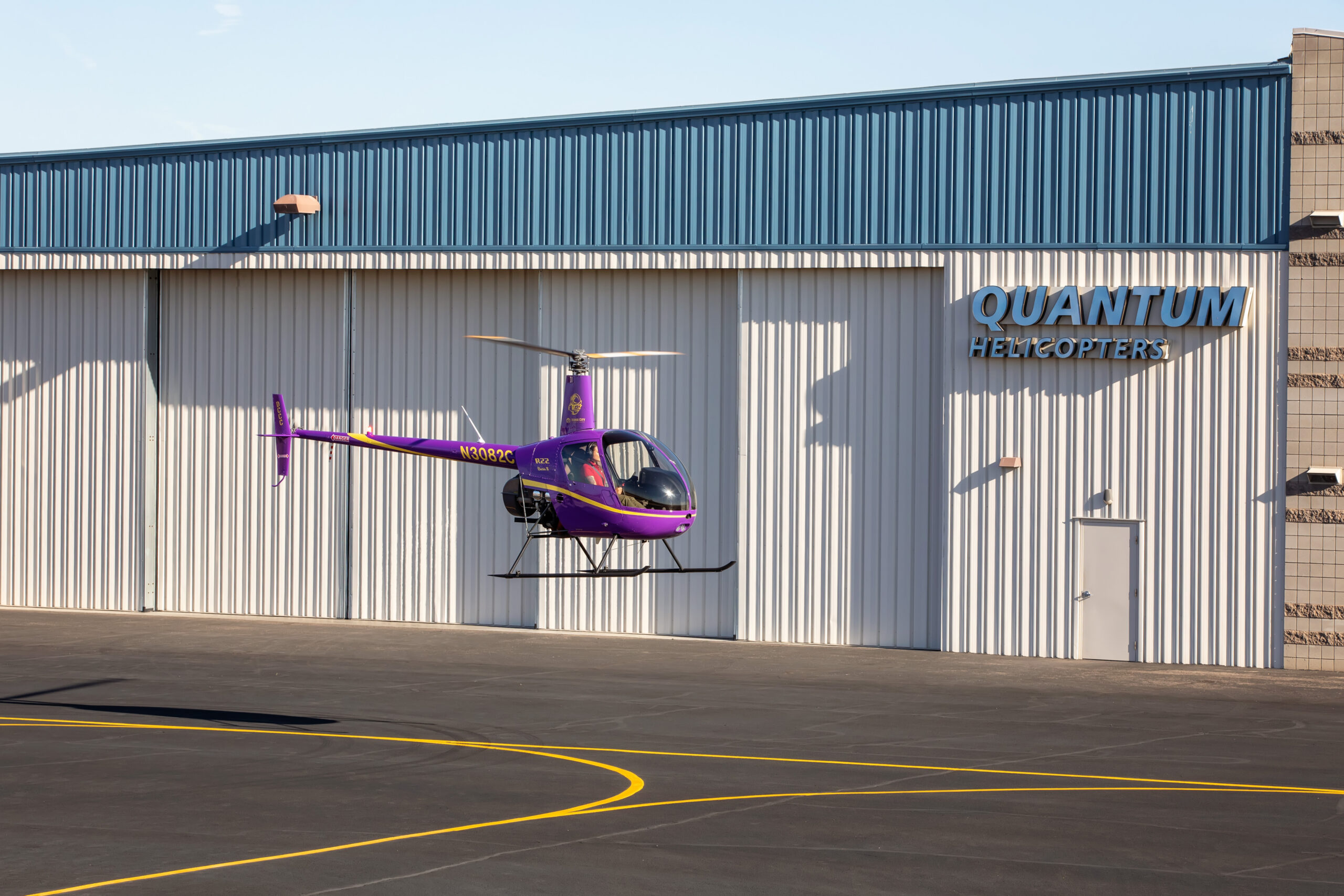 Purple Helicopter in front of Quantum Building