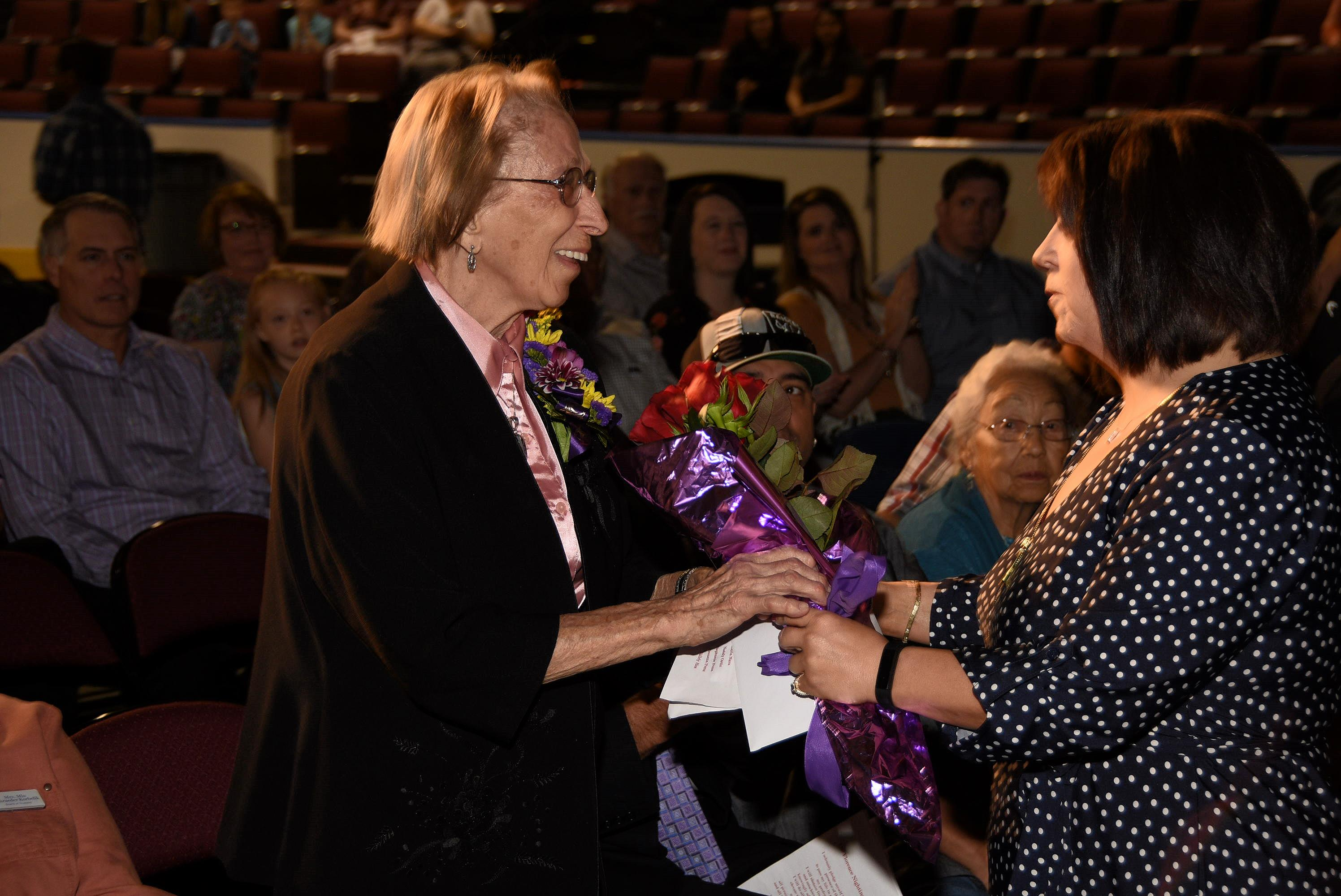 Floris Jean honored with flowers during the 2018 Nursing Pinning