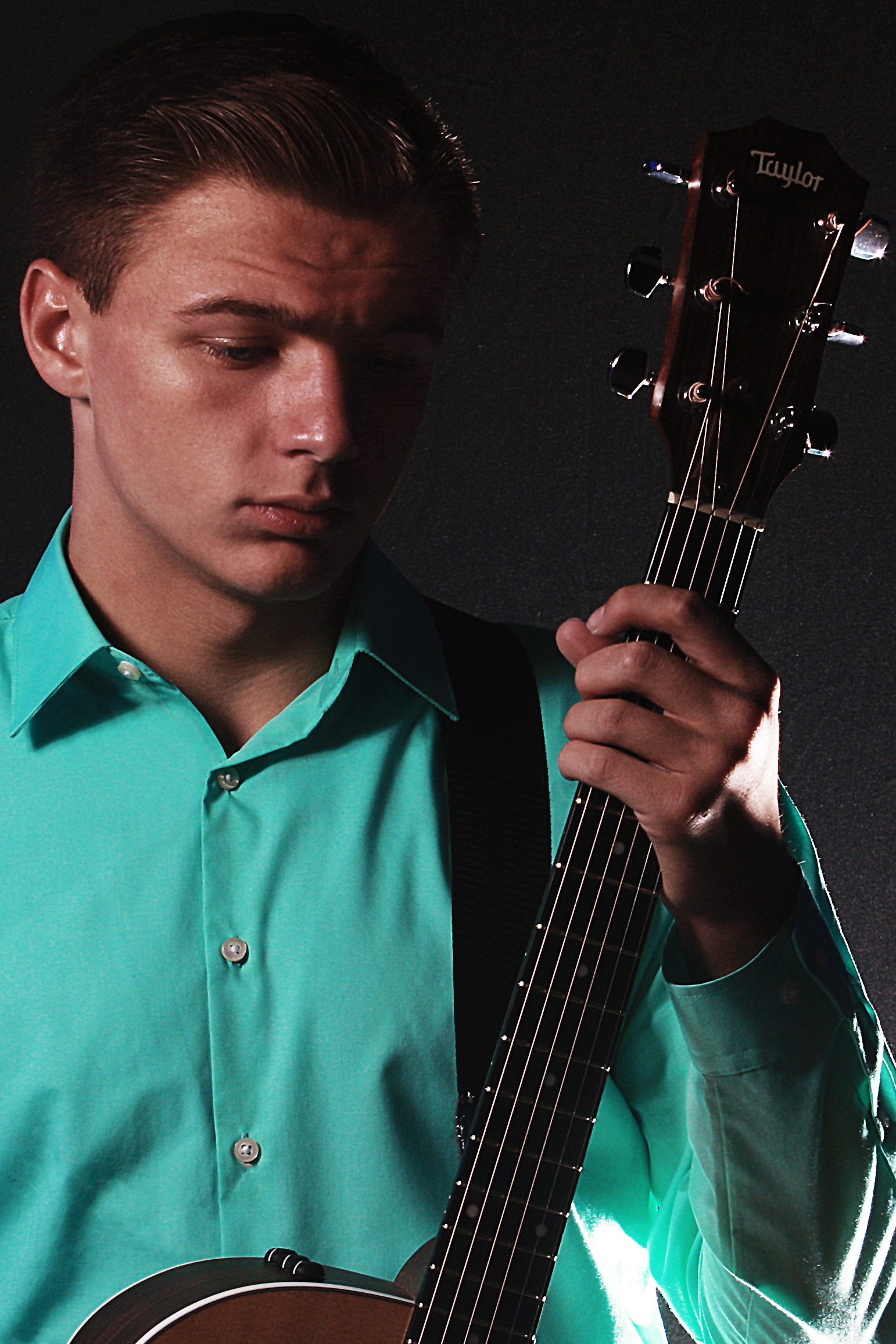 Bailey Williams posing with his guitar