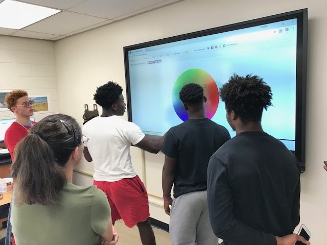 Students engage with new classroom technology, including the new smart boards