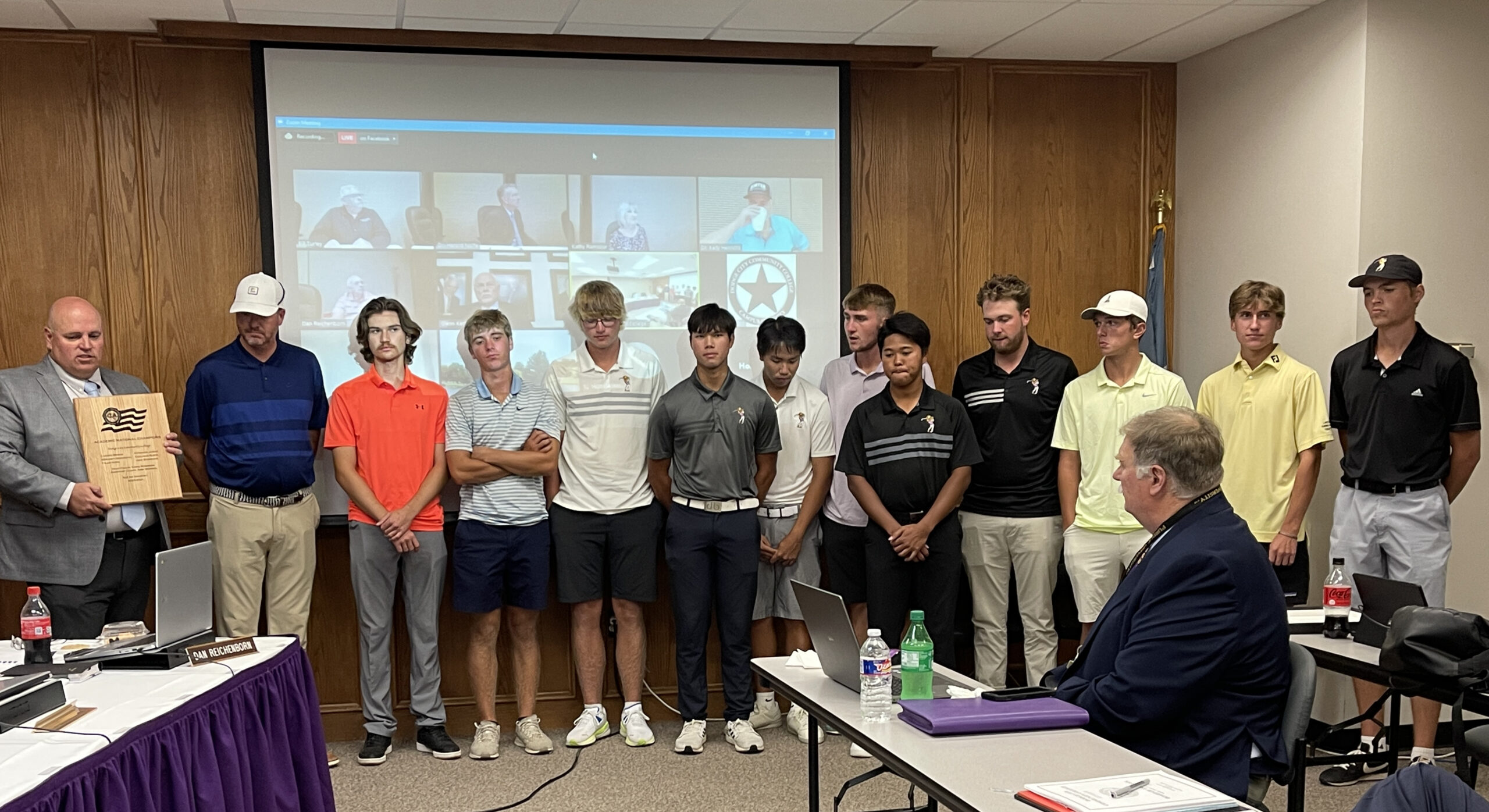 The members of the Dodge City Community College (DC3) men's golf team were recognized at the DC3 Board of Trustees meeting, on Tuesday, Sept. 28, for their recent Academic National Champions award from the Golf Coaches Association of America. Since 2012, the team has won six of these awards, with four of them being back to back. Pictured (left to right) are: Jacob Ripple, DC3 Athletic Director; Chris Robinson, DC3 Men's Golf Head Coach; Luka Stanisavljevic, freshman, South Africa; Brent Reintjes, freshman, Wichita, Kan.; Carson Briggs, sophomore, Broomfield, Colo.; Woramett Bodhidatta, Sophomore, Thailand; Cholnan Nunya, sophomore, Thailand; George Fricker, freshman, England; Kitsakon Jairak, sophomore, Thailand; Evan Lindsey, sophomore, Magnolia, Ark.; Cole Streck, freshman, Great Bend, Kan.; Austin Goodrum, freshman, Andover, Kan.; and Davan Smith, freshman, Dodge City, Kan. Not pictured is Supakit Seelanagae, freshman, Thailand. [Photo by Christina Haselhorst]