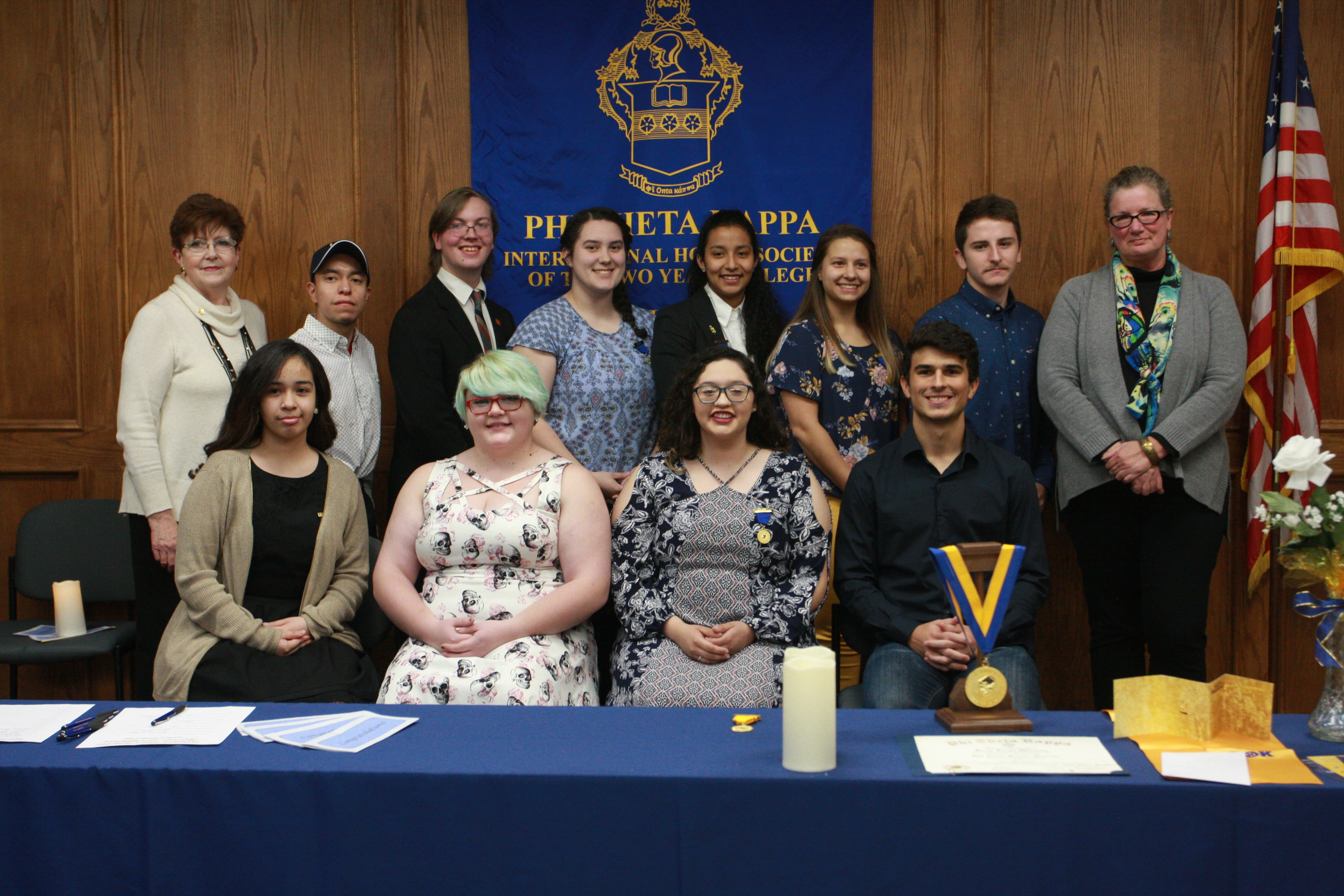 Kappa Psi new inductees posing with advisors