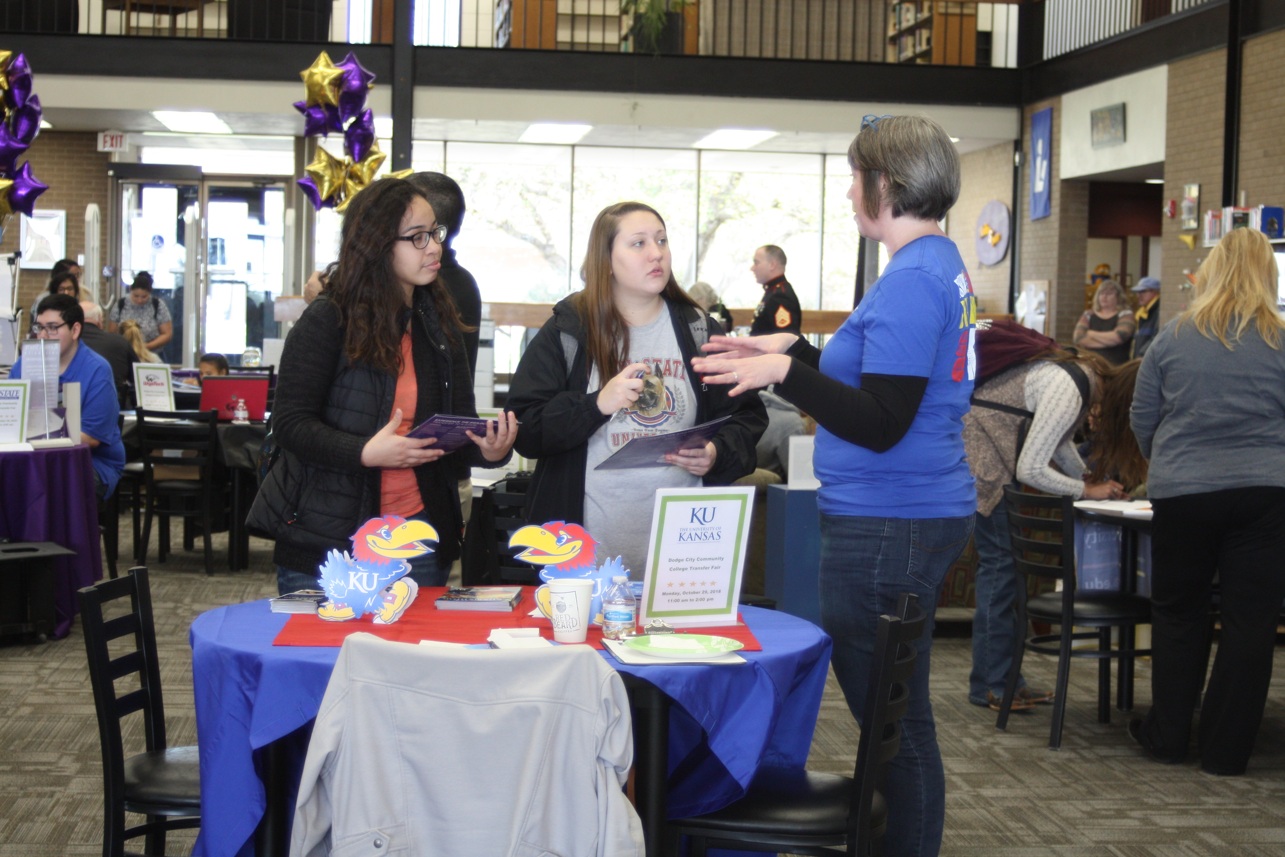 DC3 students meet with a KU representative, one of the 19 colleges from four states present at the transfer fair.