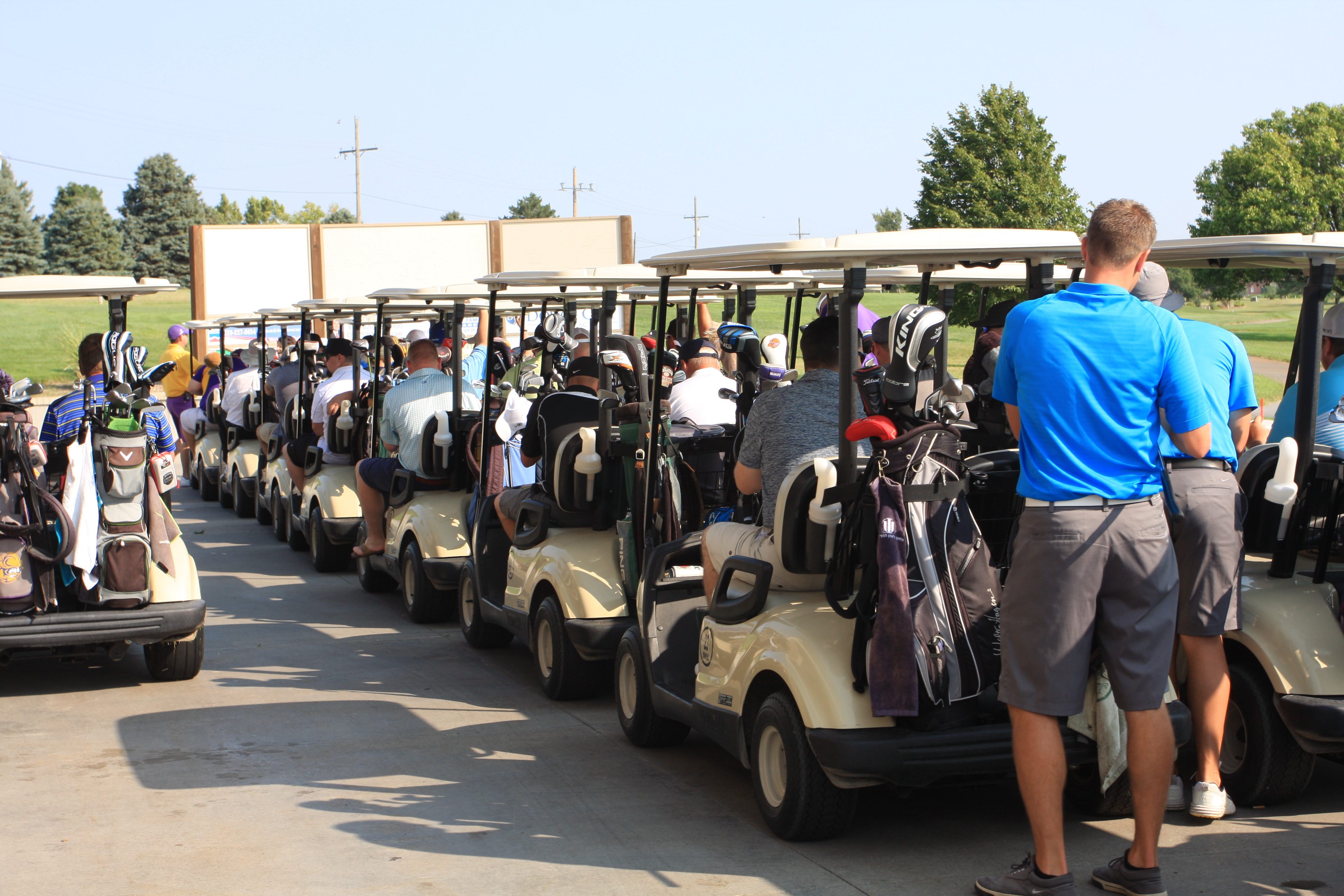 Golfers load their carts in preparation for the shotgun start to the 2018 DC3 Foundation Golf Classic