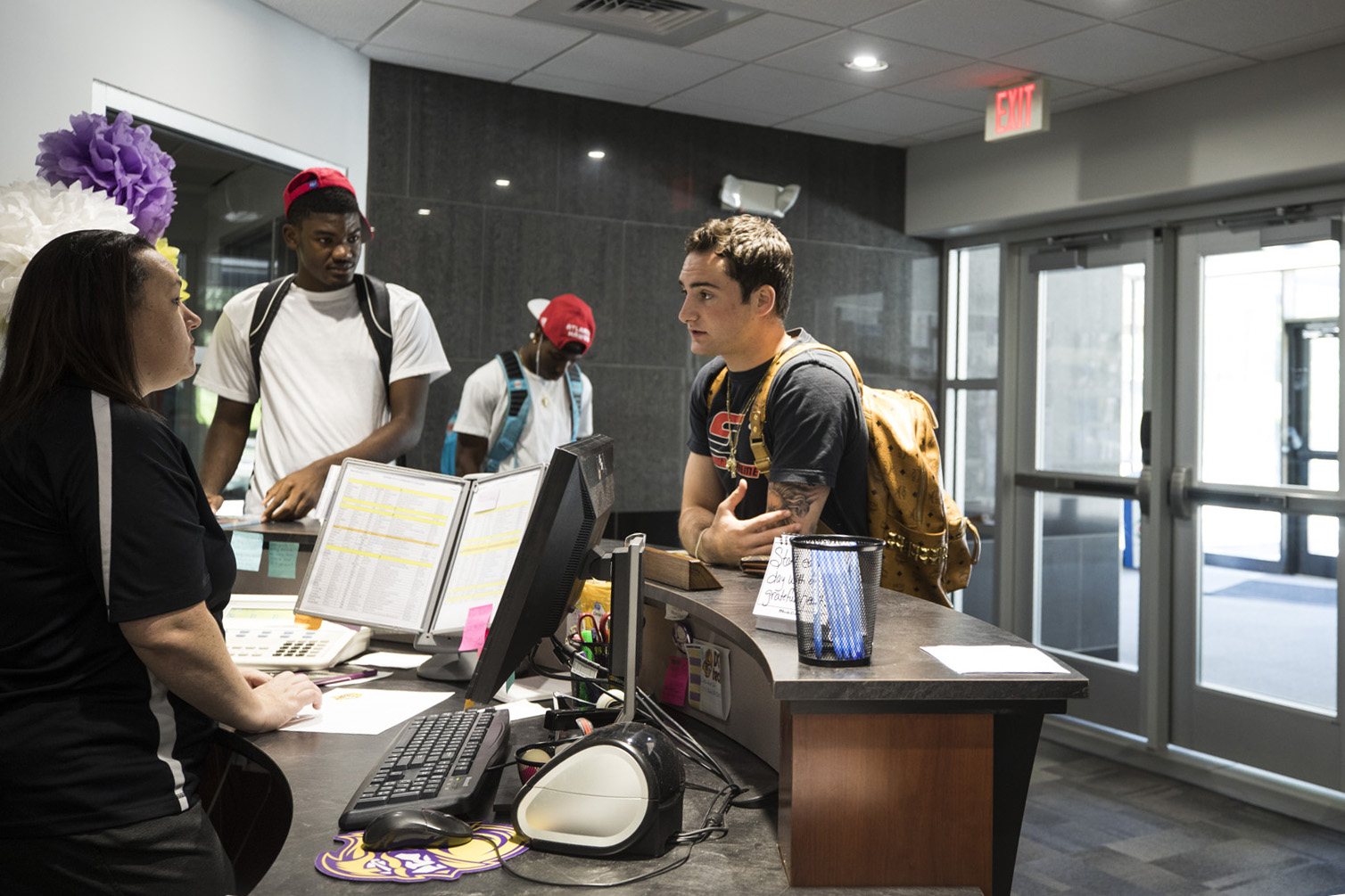 A student makes inquiries at the front desk of the DC3 student services department