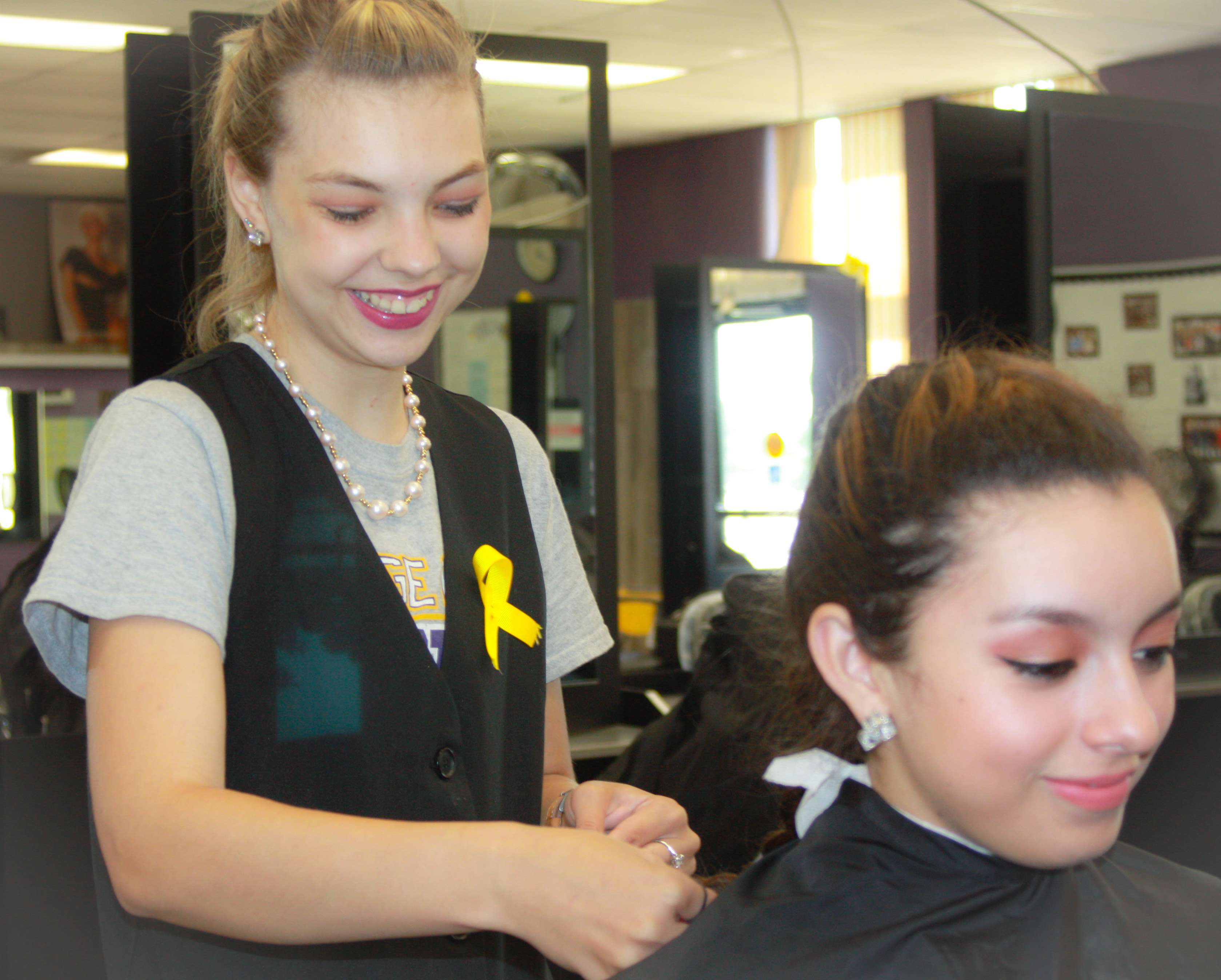 Sierra McCain works on a client in the DC3 Cosmetology salon.