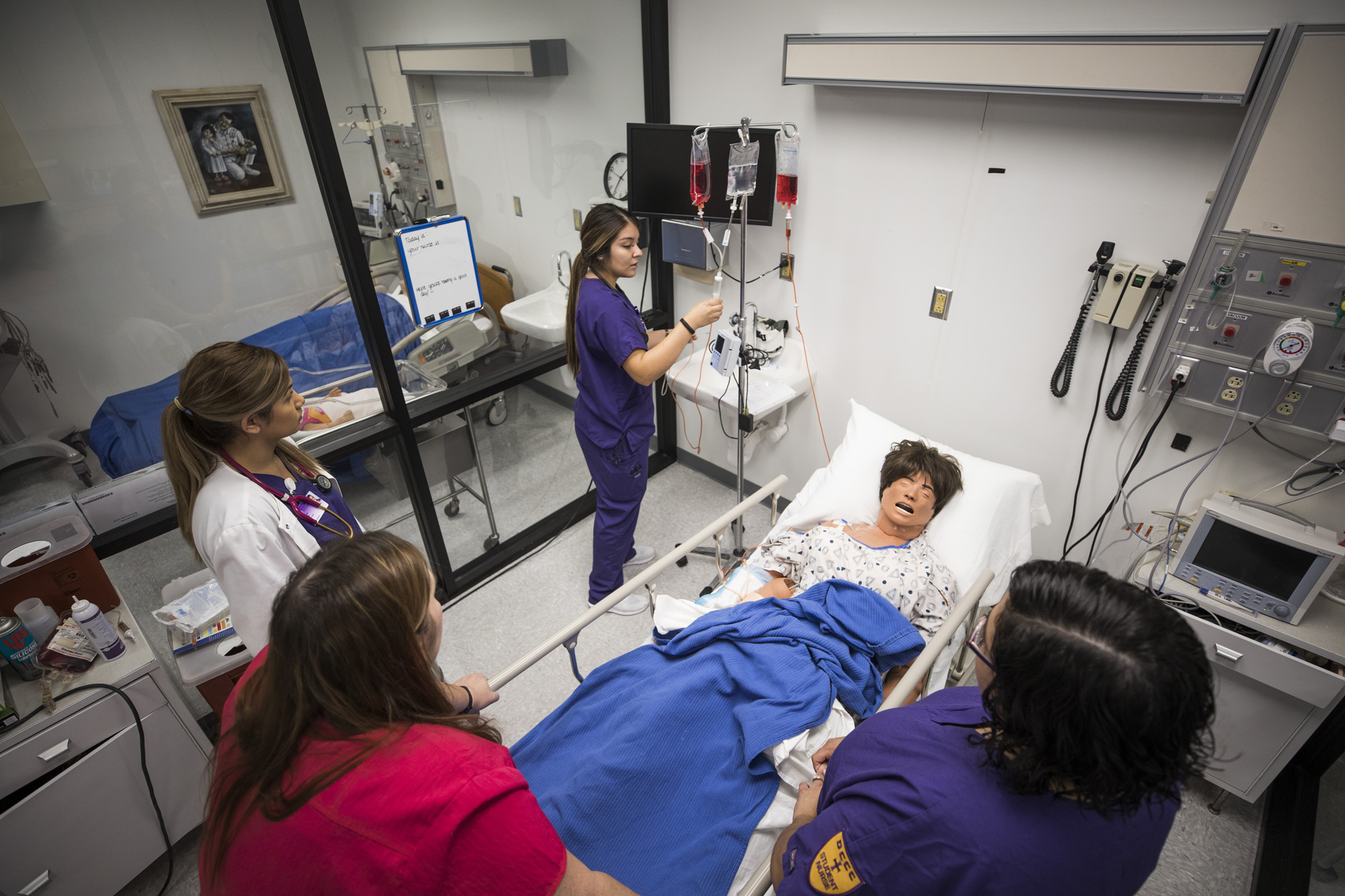 Nursing students practicing in the lab