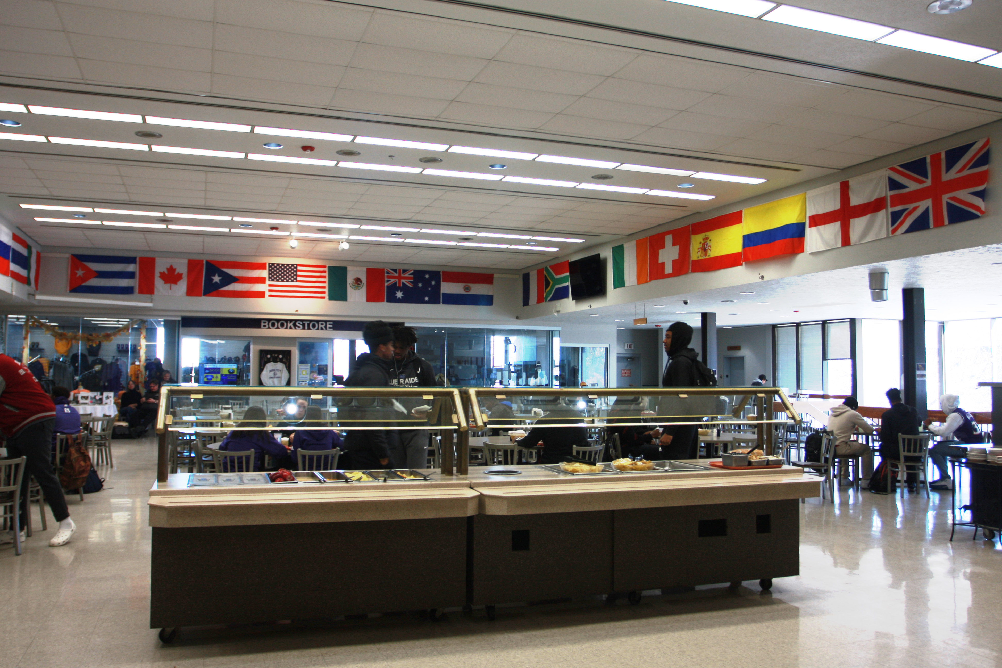 Photo of international flags from over 23 countries on display in the DC3 cafeteria