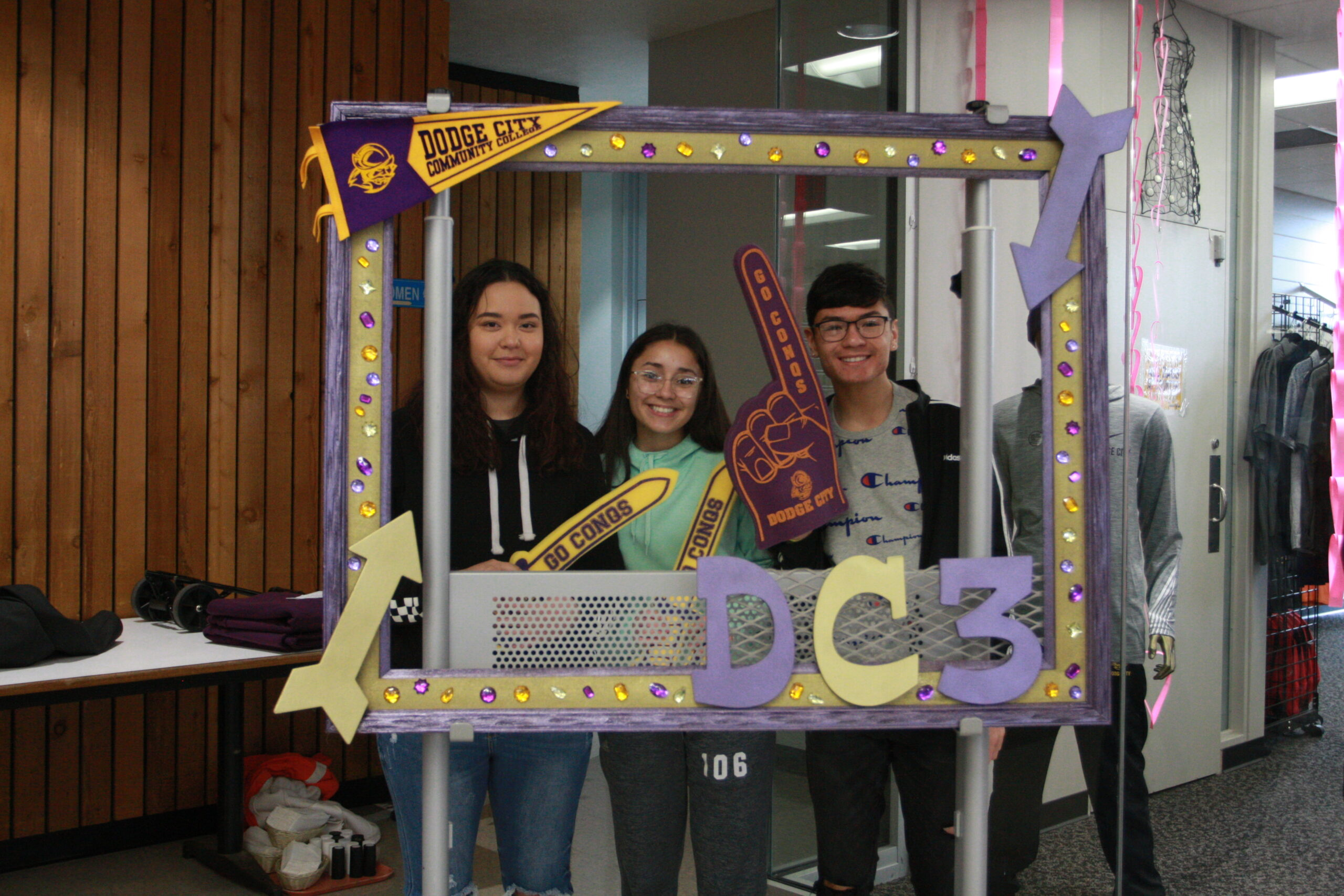 Juniors posing in a decorative frame during the 2020 Junior Experience
