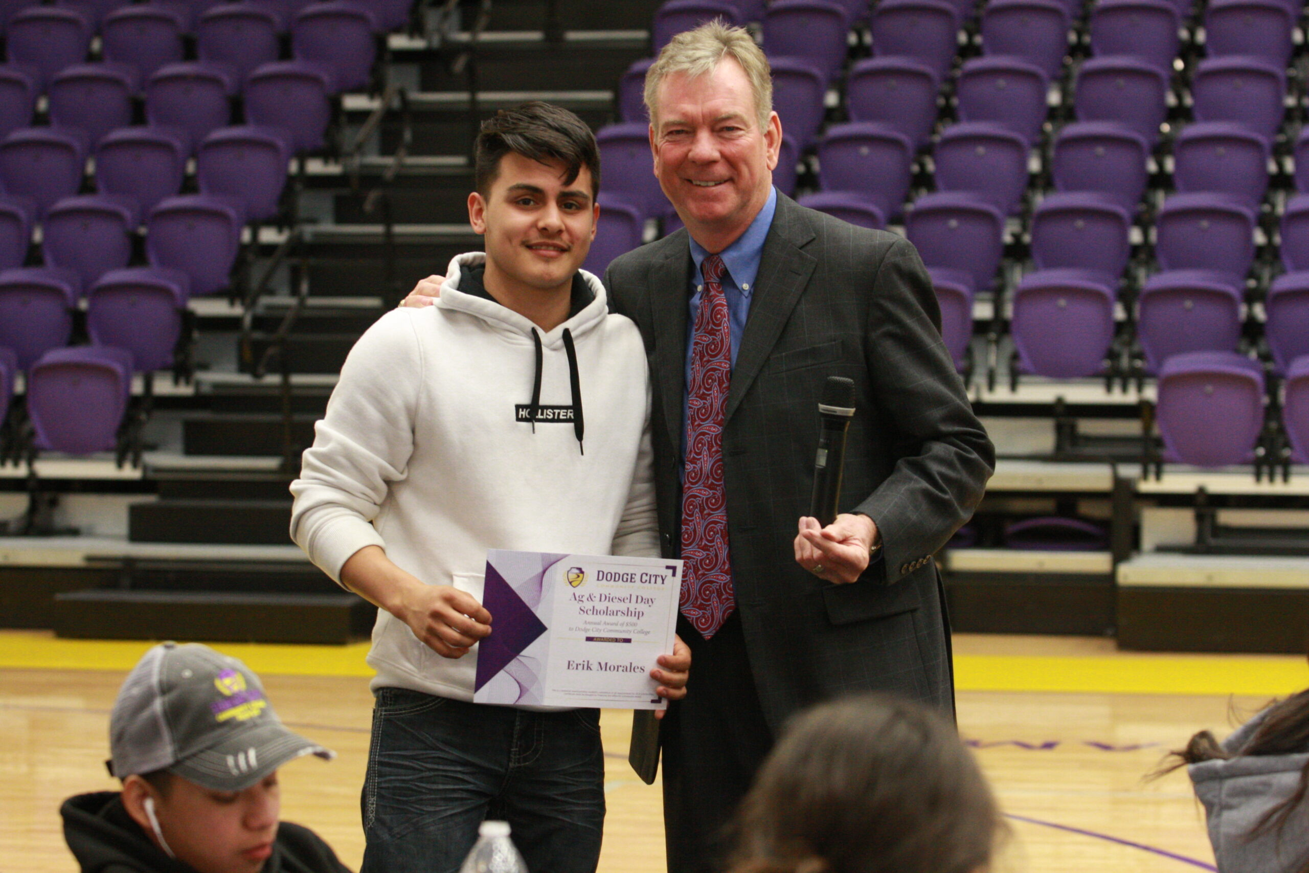 DCHS student Erik Morales poses with Dr. Harold Nolte, president of DC3 after receiving a scholarship for ag & diesel day