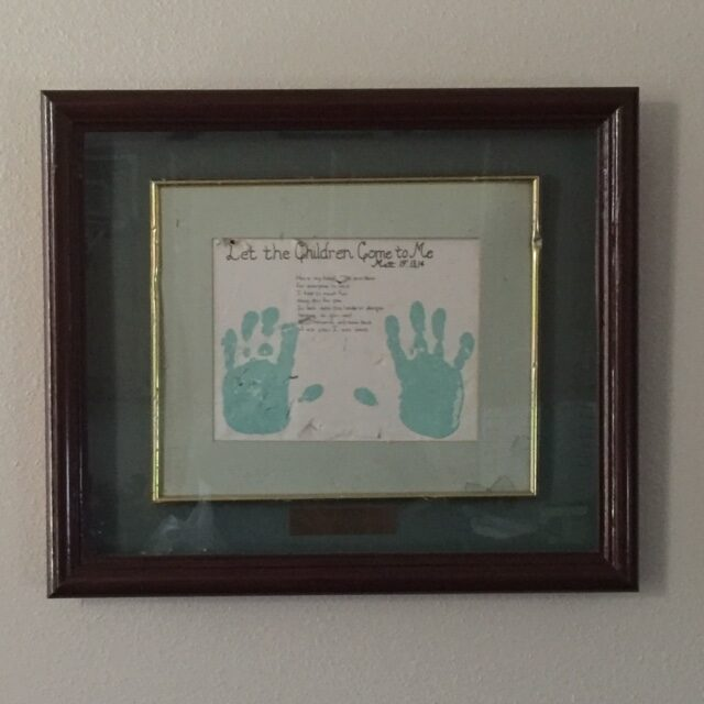 Picture of Dr. Forgey son's handprints hanging on his wall.