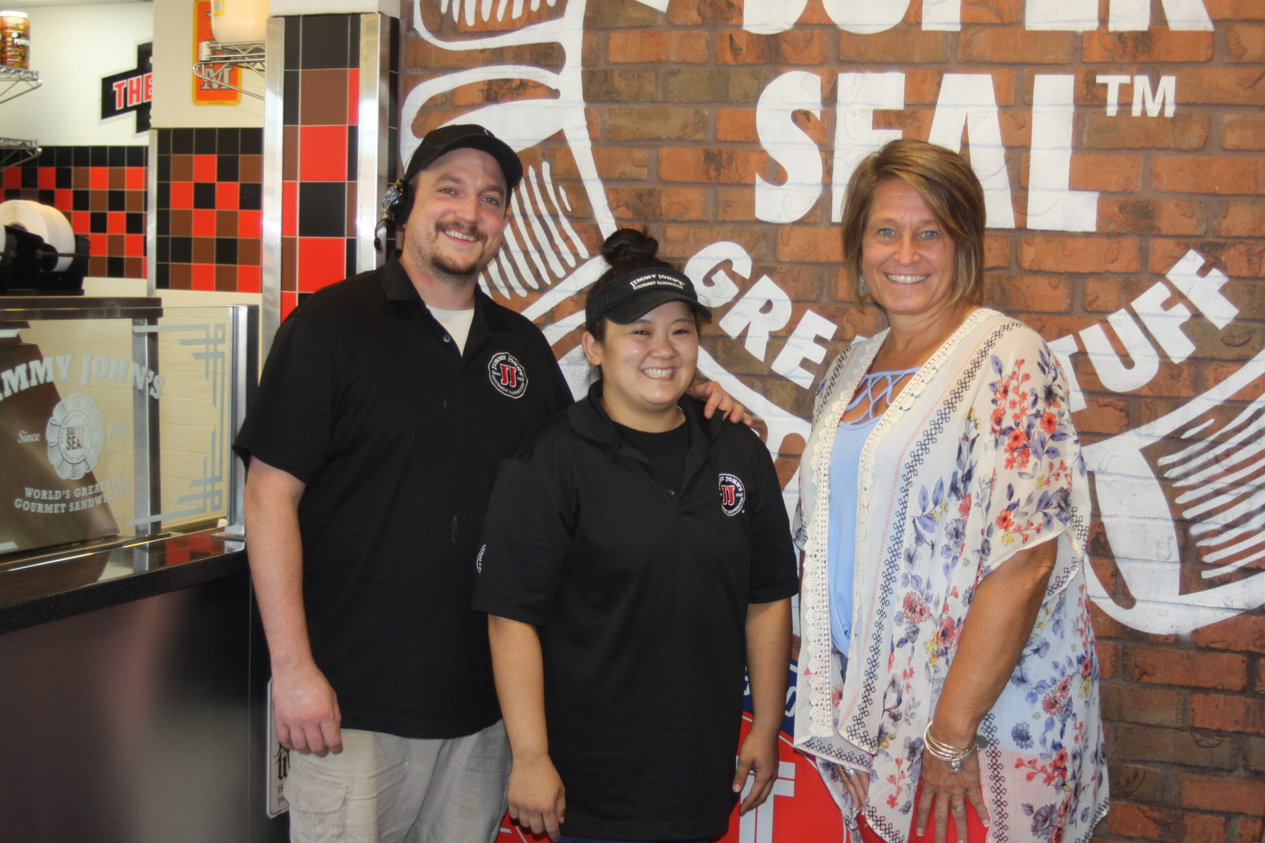 Jimmy John's owners, Larry and Jillian Janulewicz pose with DC3 Director of Marketing and Enrollment Management, Andrea Loll