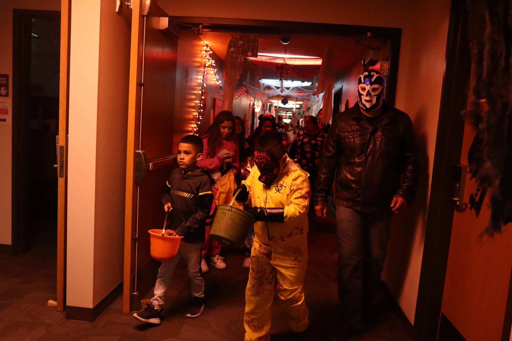 Children walking through Jackson hall during the 2019 community trick or treat
