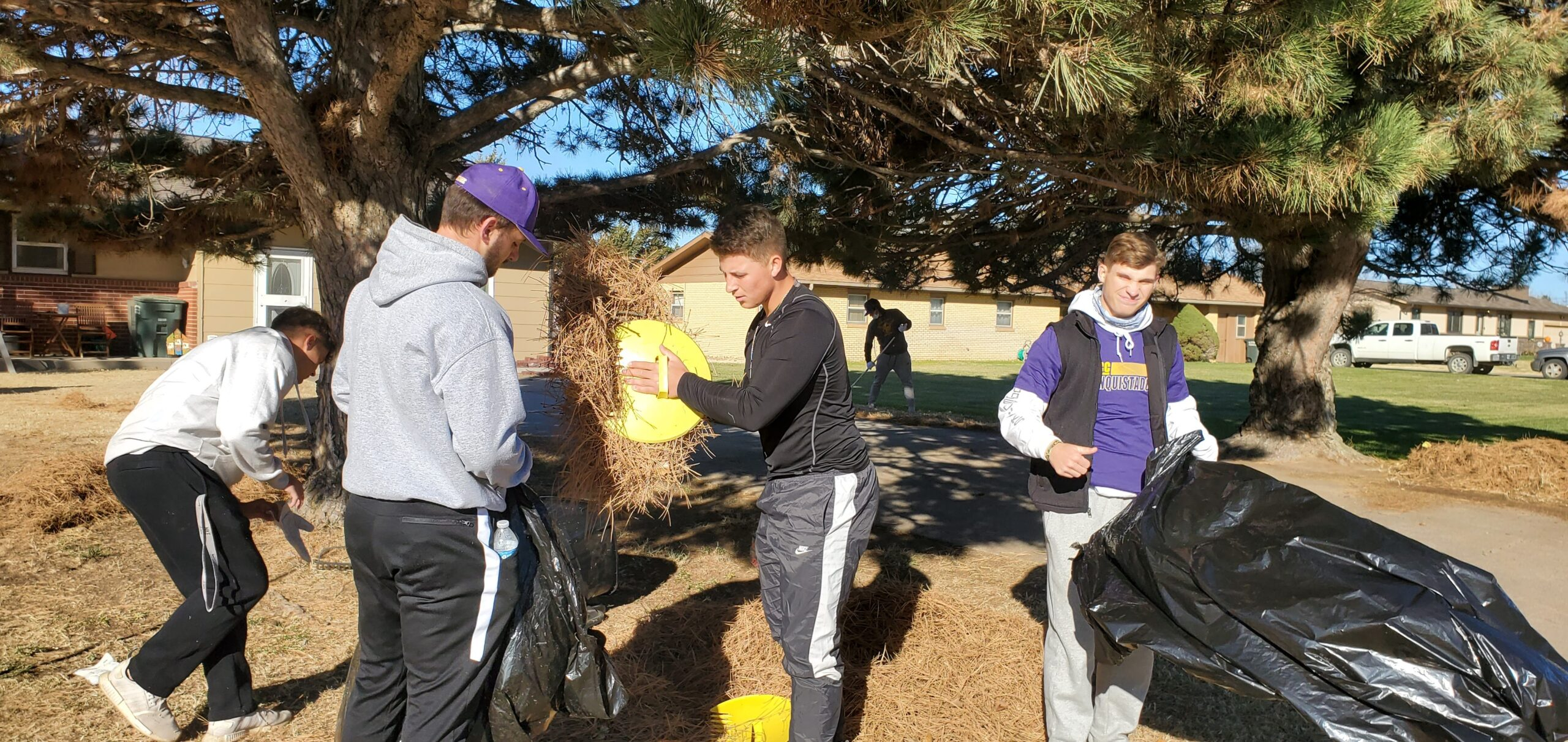 DC3 Baseball team bagging yard waste during the RSVP Annual Clean-Up Day