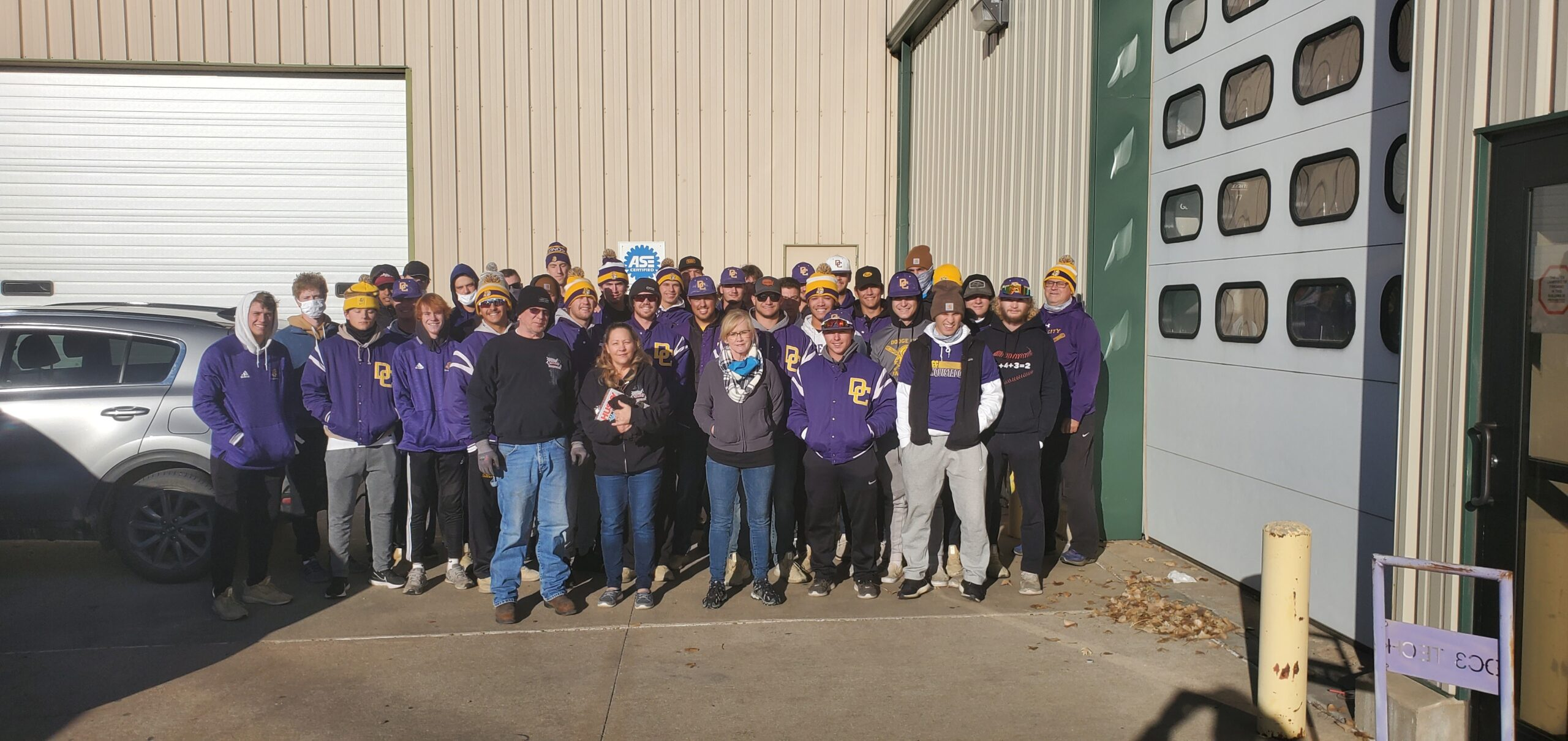 Charlotte Neuschafer, Director of Ford County RSVP and the Child and Adult Care Food Program, the DC3 Baseball team, and volunteers pose for a group photo