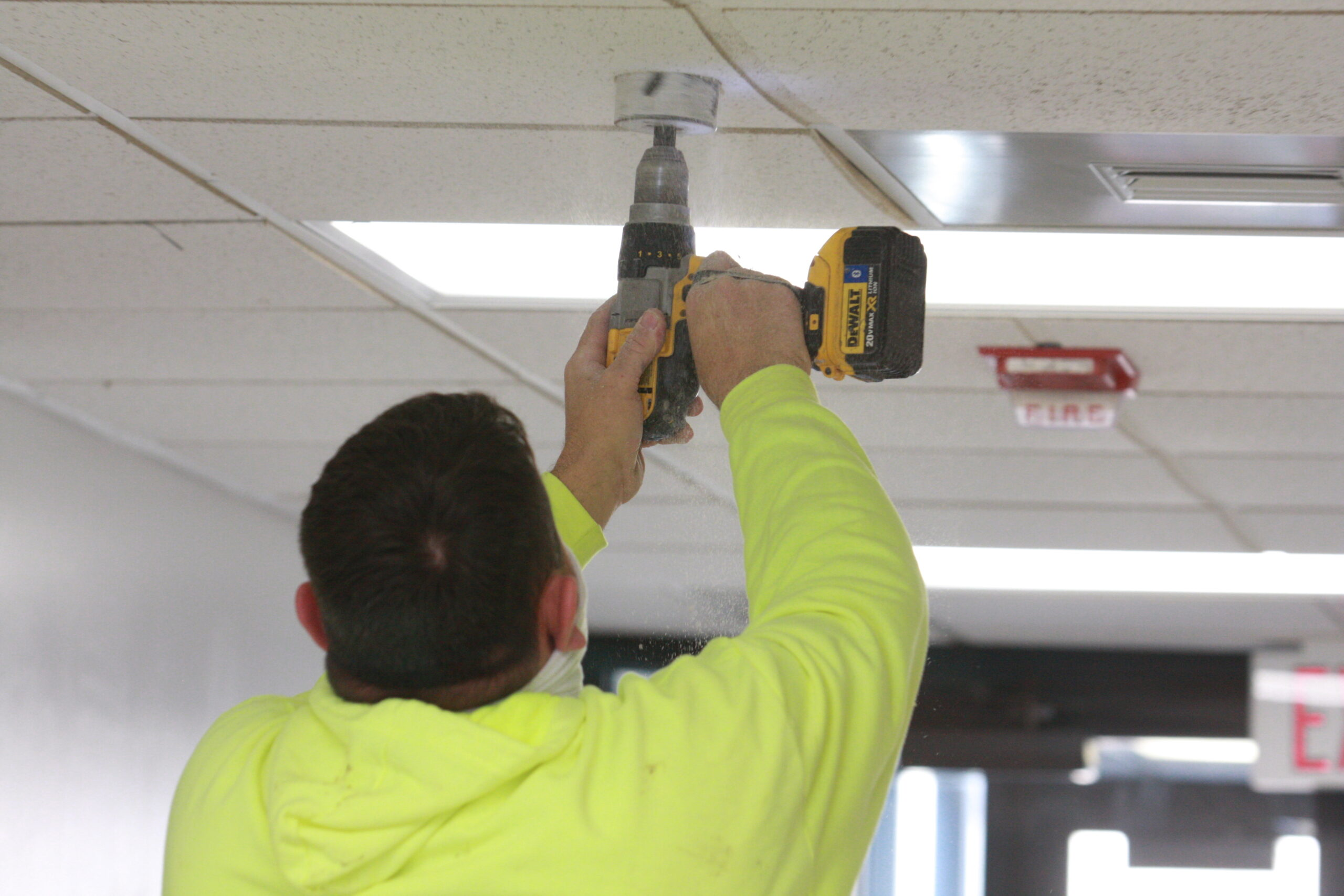 Convergint Technologies representative installing cameras
