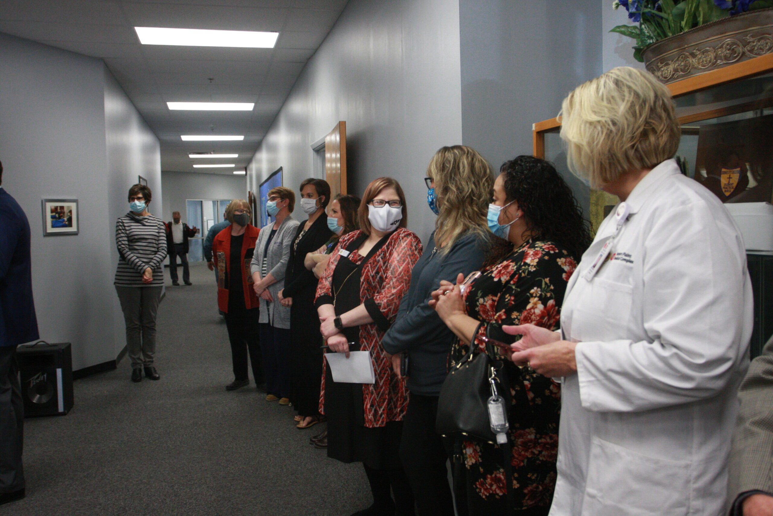 The DC3 Nursing faculty line the hall during the Floris Jean Hampton Nurse Education Center dedication