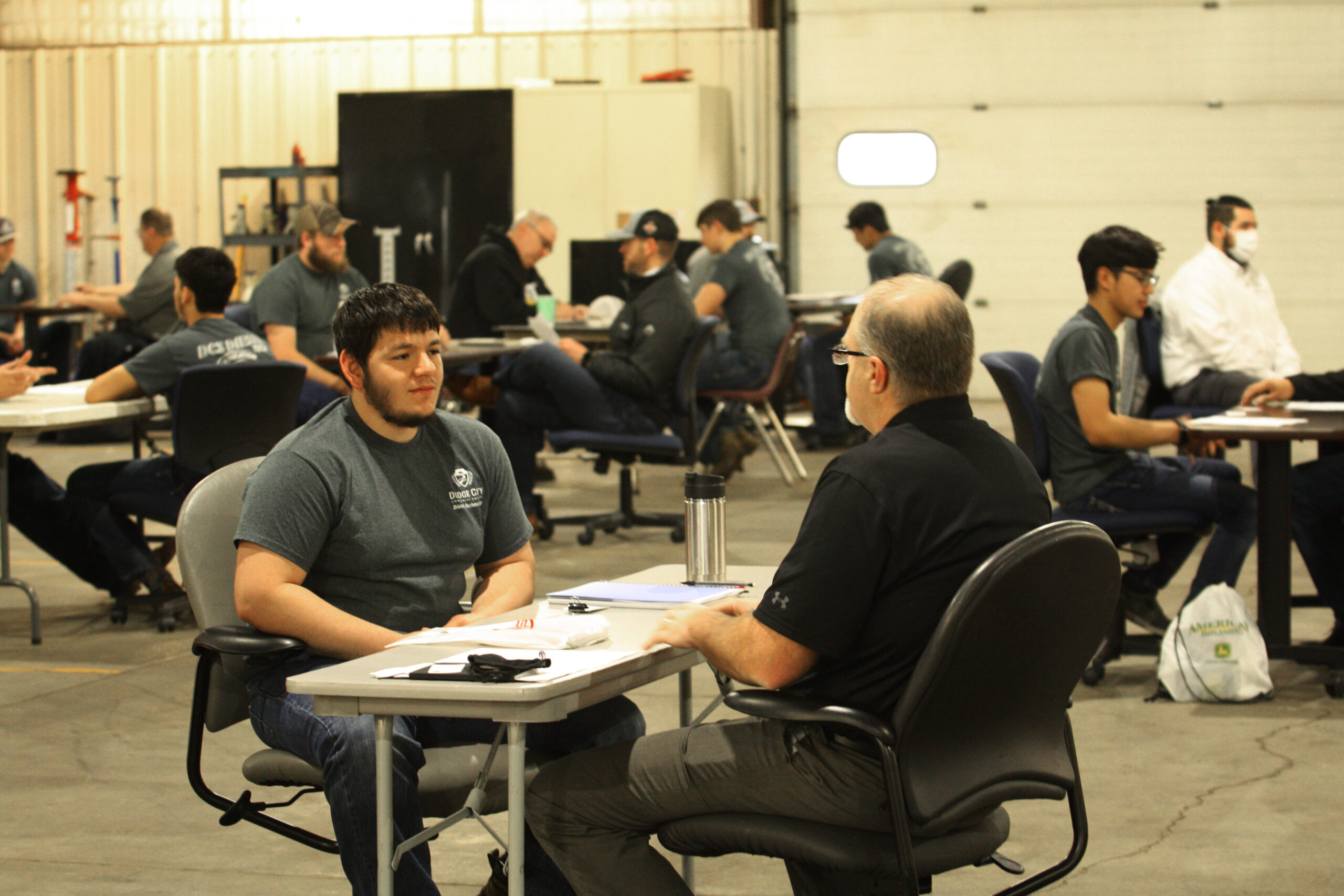 DC3 diesel tech students meet with recruiters during the college's Reverse Career Fair on Wednesday, March 24. [Photo by Justin Wilson]