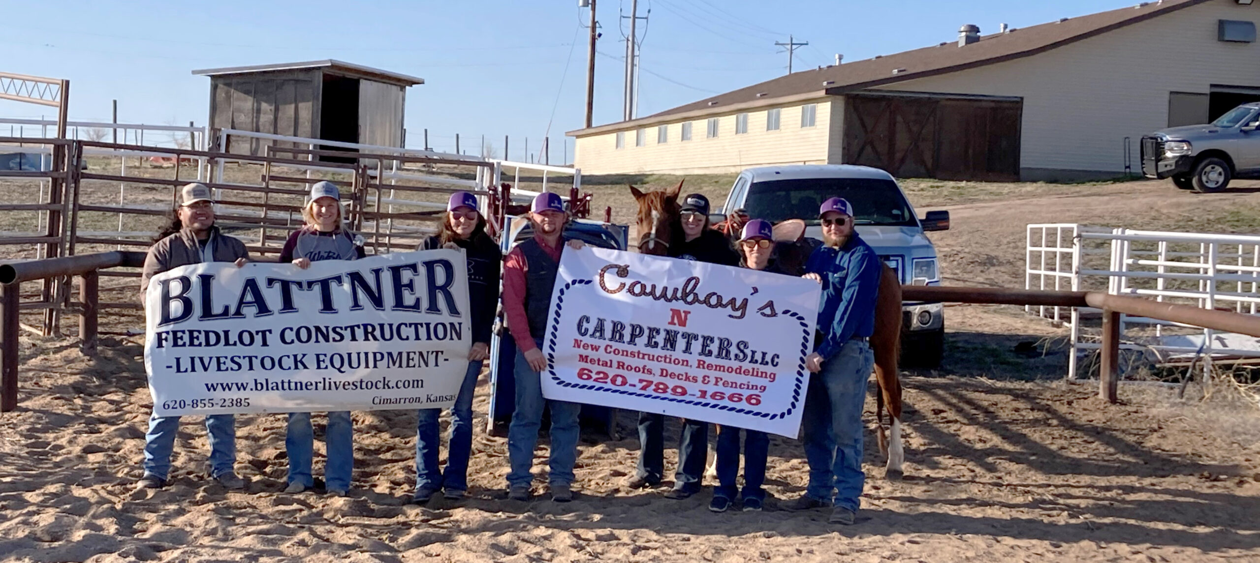 Members of the DC3 rodeo team pose with banners representing two of the three donors who provided the new roping boxes at the DC3 Rodeo Practice Arena. The area businesses involved with the project were Blattner Feedlot Construction & Livestock Equipment, Cowboys 'N' Carpenters LLC and Mead Lumber. [Photo by Tyrel Moffitt].